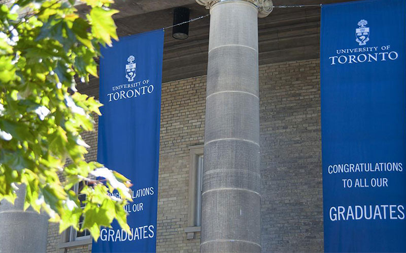 Flags celebrating graduates at the University of Toronto